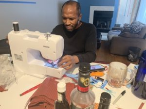 Chicagoan at home with sewing machine, making face masks for family and neighbors